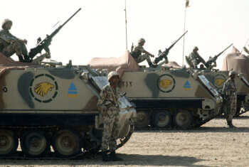 Egyptian soldiers man M-2 .50-caliber machine guns atop M-113 armored personnel carriers during a demonstration for visiting dignitaries, part of Operation Desert Shield.