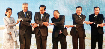 ASEAN heads of state holding hands playfully